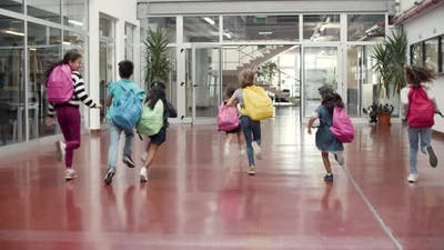 Happy Children with Colorful Backpacks Having Fun