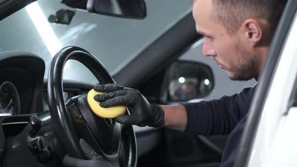 Thumbnail for Man Polish Salon of Car in a Garage