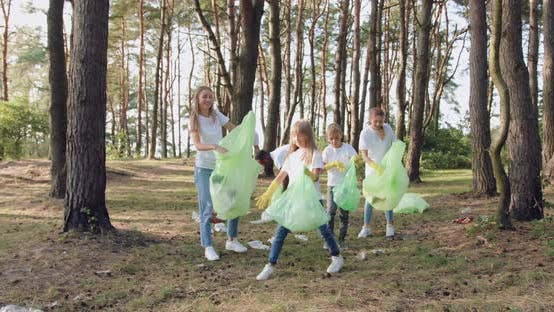 Thumbnail for Team of Volunteers in Protective Gloves Collecting Garbage Into Plastic Bags All Over the Park