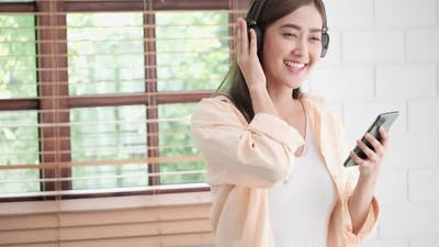 Casual woman listening with smartphone
