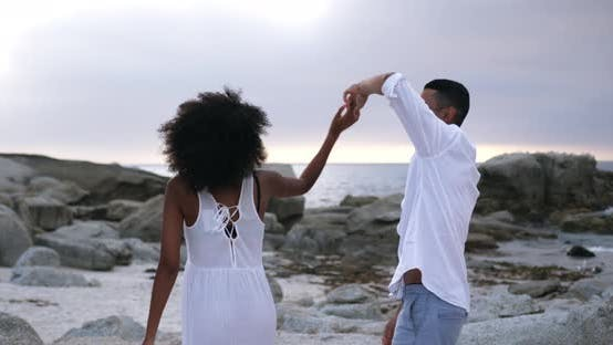 Thumbnail for Couple dancing together on the beach