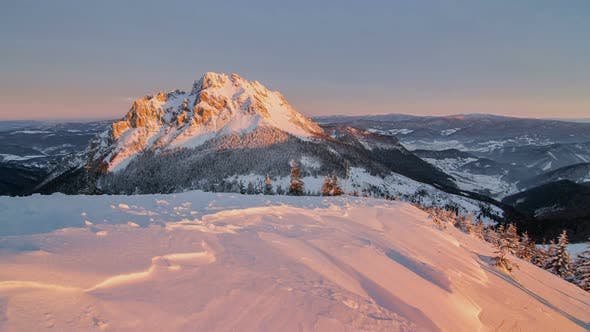 Cover Image for Sunrise in Winter Mountains