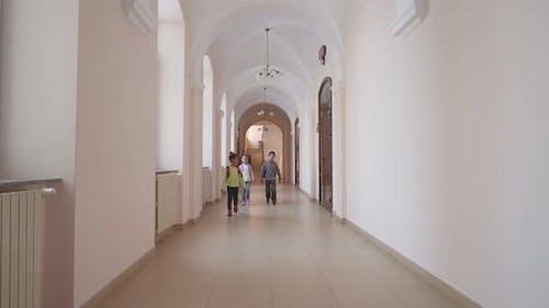 Schoolmates Walking Through Hallway