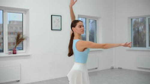 Dancer Warms Up Before Rehearsal in the White Bright Dance Hall, Ballet Rehearsal, Ballerina in the