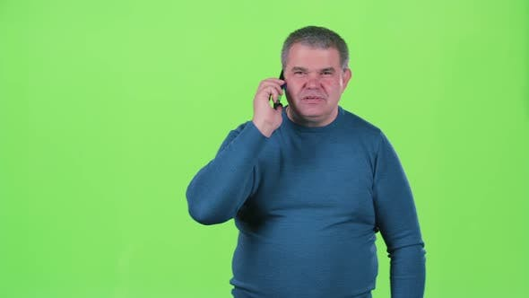Thumbnail for Man in the Age of Talking on the Phone. Green Screen