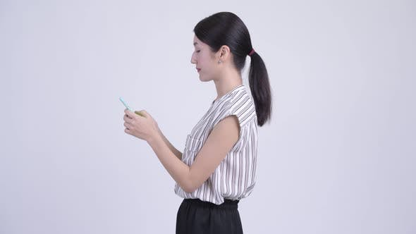 Thumbnail for Asian Businesswoman with Phone Being Taken Away