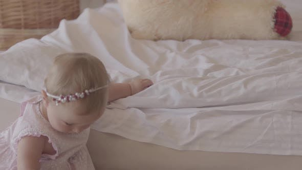 Thumbnail for Small Baby Girl Playing on the Bed Indoors. Cute Child at Home. Beautiful Child with Mother. Having
