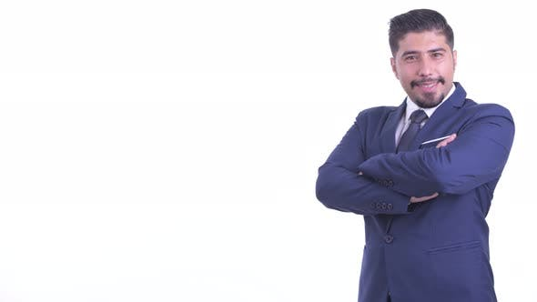 Thumbnail for Profile View of Happy Bearded Persian Businessman Smiling with Arms Crossed