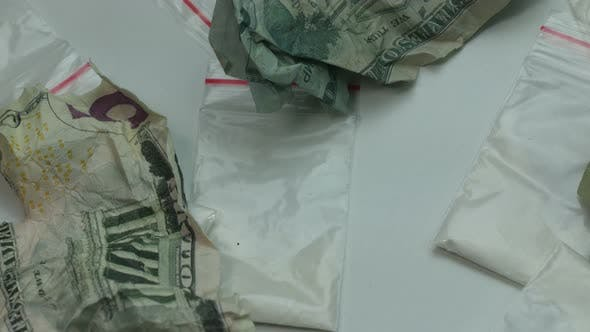 Thumbnail for Portions of Cocaine and Crumpled Money