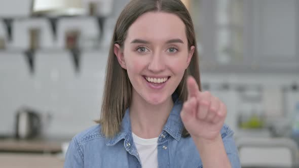 Thumbnail for Portrait of Cheerful Young Woman Pointing and Inviting