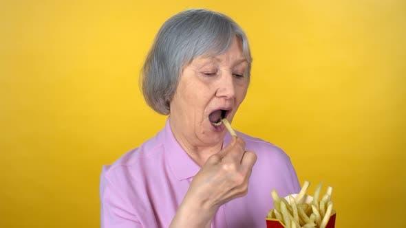 Thumbnail for Senior Woman Eating Fries