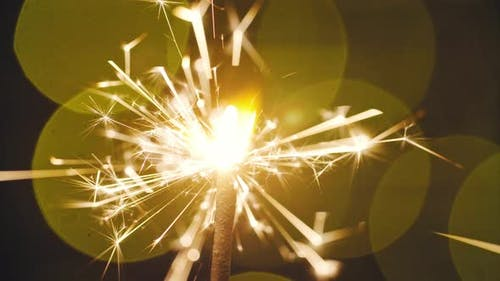 Cinemagraph; Burning Sparkler on Bokeh Background