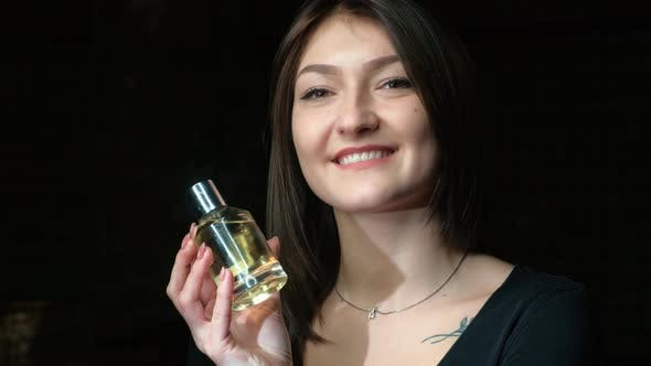 Thumbnail for Portrait of a Beautiful Girl with a Perfume Bottle