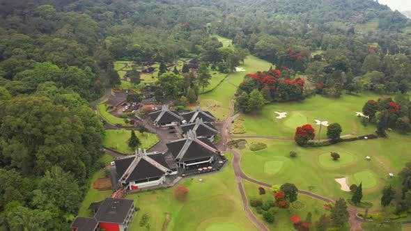 Cover Image for Golf Club in the Mountains in Bedugul, Bali, Indonesia. Aerial View .