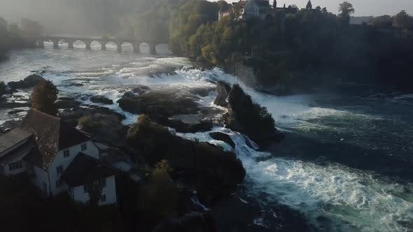 Thumbnail for Aerial Revealing Shot Of Rhine Falls In Switzerland Early In The Morning
