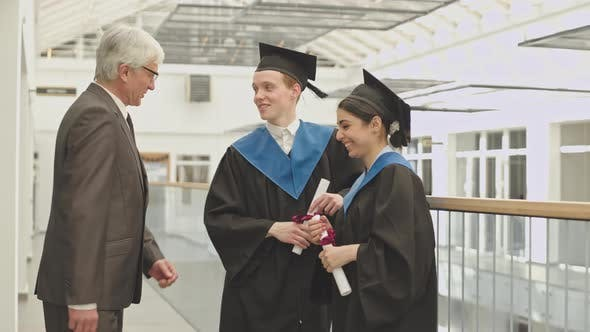 University Tutor Congratulating Graduates
