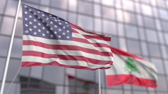 Flags of the USA and Lebanon in Front of a Skyscraper
