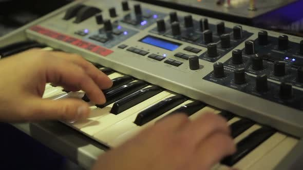 Thumbnail for Musician Playing Synthesizer at Concert, Expensive Sound Equipment, Music