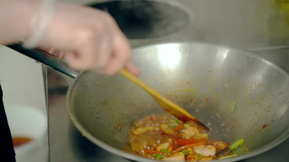 Thumbnail for Cook Mixes Shrimps with Vegetables in a Frying Pan. Then He Separates Shrimp From Vegetables.