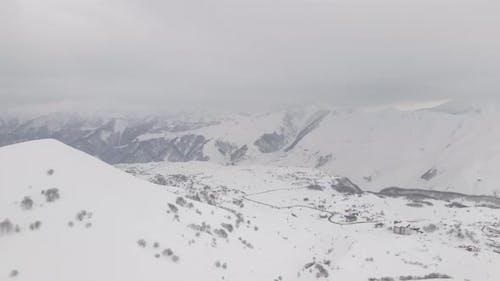 Aerial view of beautiful snowy mountains in Gudauri. Georgia