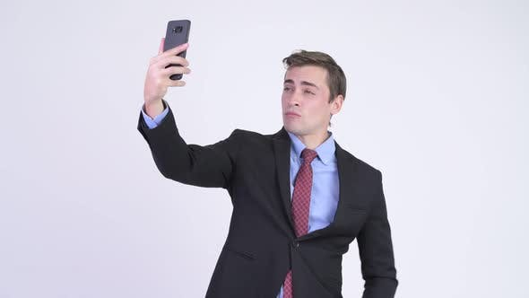 Thumbnail for Young Handsome Businessman Taking Selfie