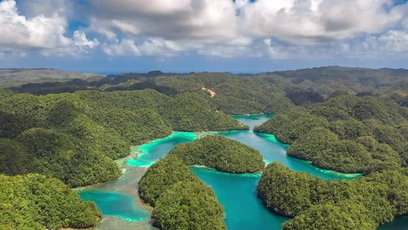 Cover Image for Tropical Landscape Rainforest Hills and Azure Water in Lagoon with Clouds. Сoast on the Siargao