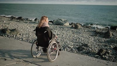 Lonely Disabled Woman Looking at Sea