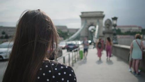 Female Tourist on Famous Szechenyi Chain Bridge in Budapest
