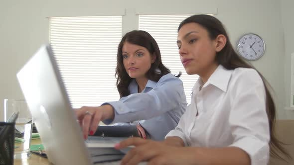 Three business women working together as a team on computer