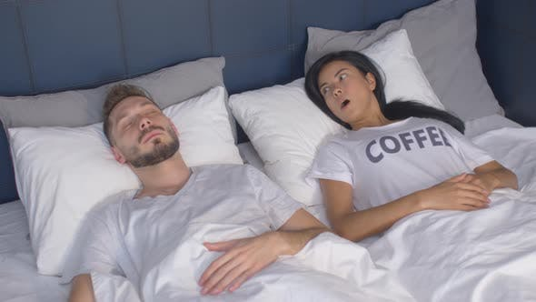 Thumbnail for Man Waking Up after Oversleeping with Help of Wife