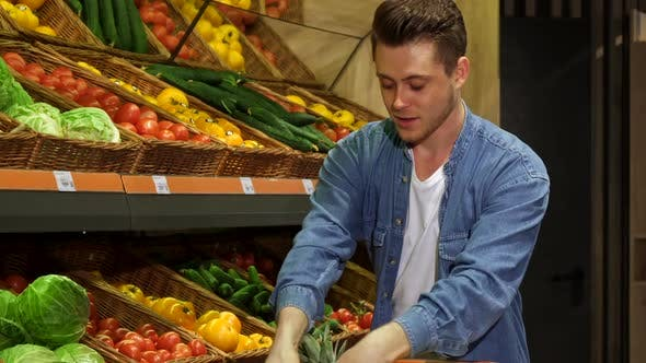 Thumbnail for Guy Buys Fruits and Vegetables at the Hypermarket