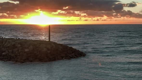 Thumbnail for Lighthouse At Sea At Sunset