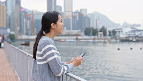 Thumbnail for Woman use of mobile phone at outdoor