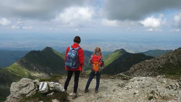 Thumbnail for Two Sisters Hikers Standing On A Mountain Summit