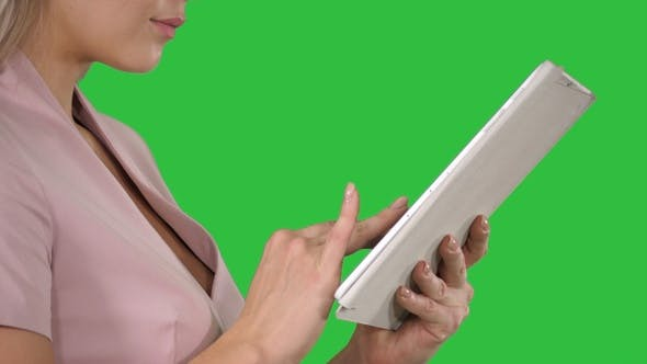 Thumbnail for Female hands using tablet on a Green Screen, Chroma Key.