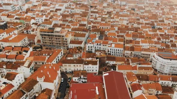 Aerial View of White Dense Building with Terracotta Roofs