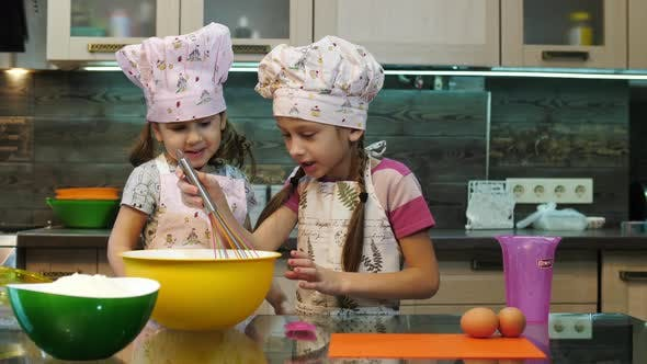 Girls mixing ingredients in a bowl