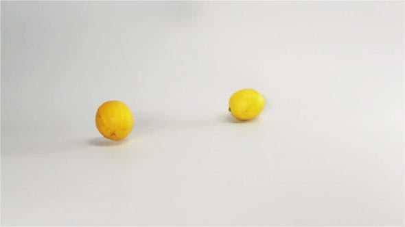 Cover Image for Fresh Yellow Lemons Falling Down on White Surface