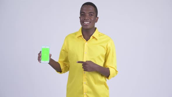 Thumbnail for Young Happy African Businessman Showing Phone and Giving Thumbs Up