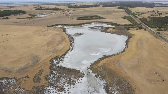 Thumbnail for Aerial footage of a dry agricultural dam in regional Australia