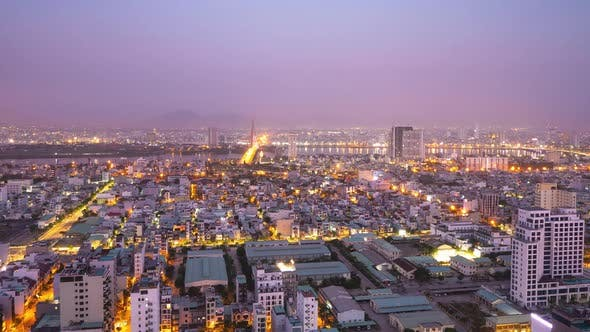 Cinematic Timelapse View of an Industrialized City in Asia From Night to Day