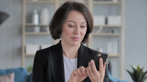 Thumbnail for Old Businesswoman Browsing Smartphone