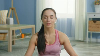 Young Woman Practices Relaxing Breathing