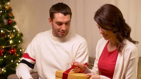 Thumbnail for Happy Couple with Christmas Gift at Home