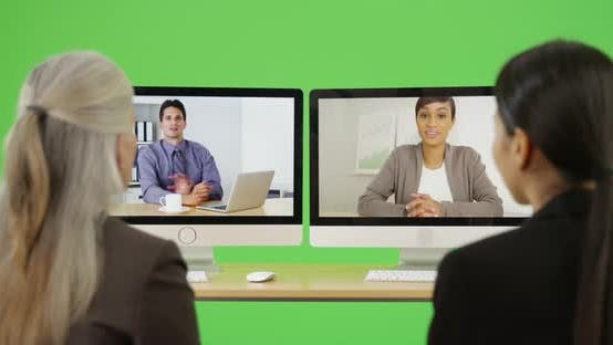 Thumbnail for A team of office professionals have a video chat on green screen