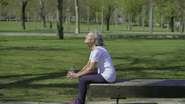 Thumbnail for Tired Elderly Woman Resting After Workout in Park