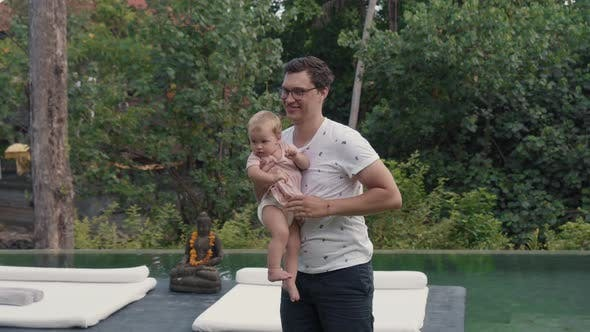 Toddler Learning to Walk in Garden