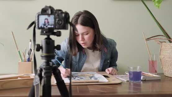 Thumbnail for Teenager Girl Painting with Watercolors, Sitting at Home at the Table. Art, Education, Creativity