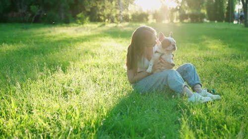 Young Woman Showing Love To French Bulldog.