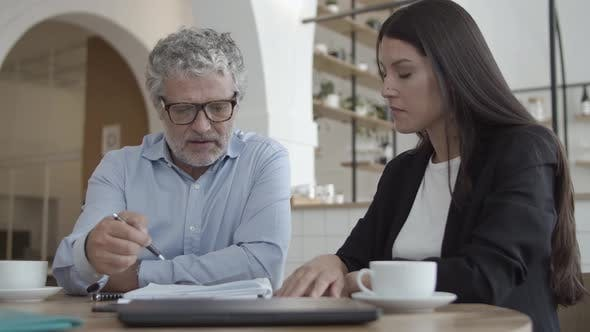 Thumbnail for Grey Haired Businessman Meeting with Insurance Agent